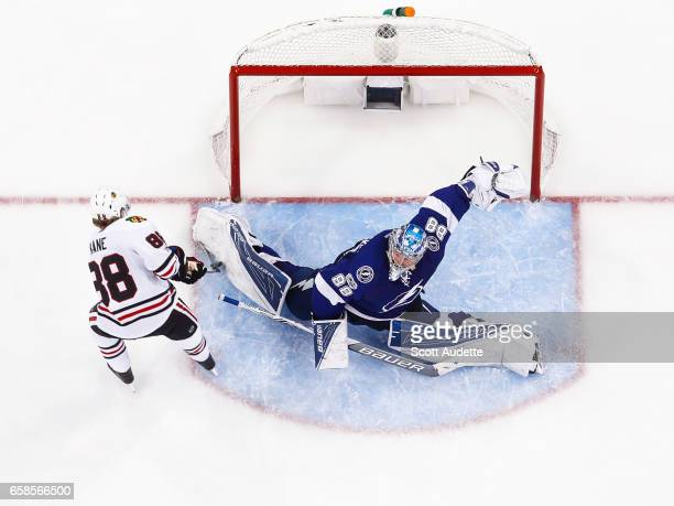 Goalie Andrei Vasilevskiy of the Tampa Bay Lightning makes a save against Patrick Kane of the Chicago Blackhawks during third period at Amalie Arena...