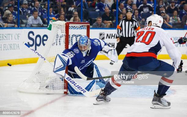 Goalie Andrei Vasilevskiy of the Tampa Bay Lightning makes a save against Lars Eller of the Washington Capitals during the second period at Amalie...