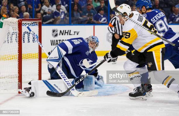 Goalie Andrei Vasilevskiy of the Tampa Bay Lightning makes a save against Jake Guentzel of the Pittsburgh Penguins during the second period at Amalie...