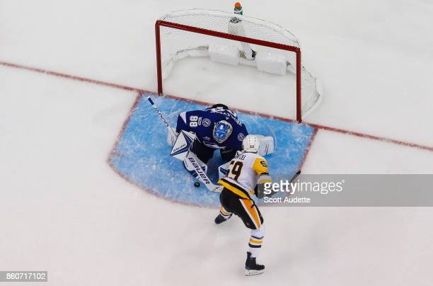 Goalie Andrei Vasilevskiy of the Tampa Bay Lightning makes a save against Jake Guentzel of the Pittsburgh Penguins during the third period at Amalie...