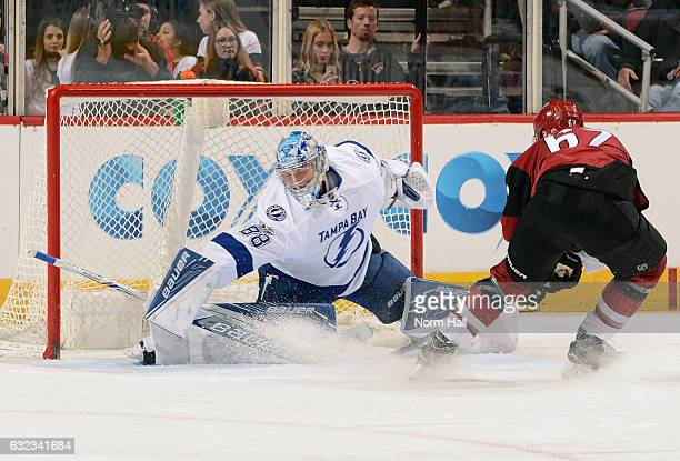 Goalie Andrei Vasilevskiy of the Tampa Bay Lightning makes a stick save on the shot by Lawson Crouse of the Arizona Coyotes during the third period...