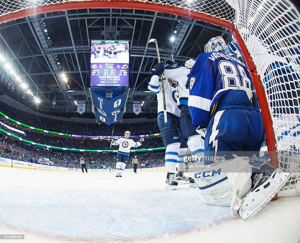 Goalie <a gi-track='captionPersonalityLinkClicked' href=/galleries/search?phrase=Andrei+Vasilevskiy+-+Ice+Hockey+Player&family=editorial&specificpeople=9594320 ng-click='$event.stopPropagation()'>Andrei Vasilevskiy</a> #88 of the Tampa Bay Lightning reacts to a goal for the Winnipeg Jets during the third period at the Amalie Arena on February 18, 2016 in Tampa, Florida.