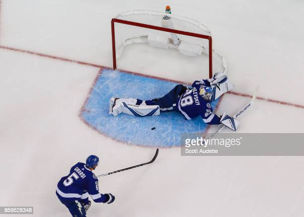 Goalie Andrei Vasilevskiy of the Tampa Bay Lightning stretches to make a save against the Washington Capitals during the first period at Amalie Arena...
