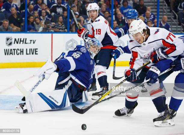 Goalie Andrei Vasilevskiy of the Tampa Bay Lightning stretches to make a save against TJ Oshie of the Washington Capitals during the second period at...