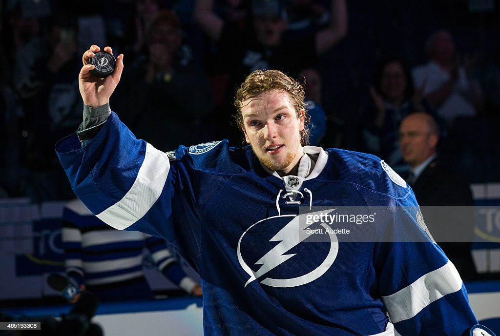 Goalie <a gi-track='captionPersonalityLinkClicked' href=/galleries/search?phrase=Andrei+Vasilevskiy+-+Ice+Hockey+Player&family=editorial&specificpeople=9594320 ng-click='$event.stopPropagation()'>Andrei Vasilevskiy</a> #88 of the Tampa Bay Lightning thanks fans for their support after being name the first star of the game against the Buffalo Sabres at the Amalie Arena on March 3, 2015 in Tampa, Florida.