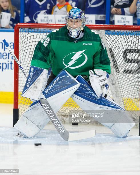 Goalie Andrei Vasilevskiy of the Tampa Bay Lightning wears a green St Patrick's Day warmup jersey as he gets ready to play against the Toronto Maple...