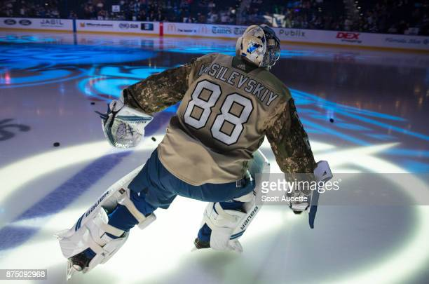 Goalie Andrei Vasilevskiy of the Tampa Bay Lightning wears a Military Appreciation Night jersey for pregame warm ups against the Dallas Stars at...