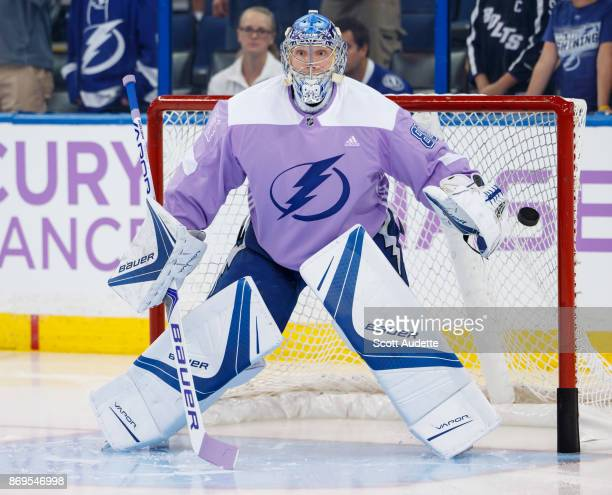 Goalie Andrei Vasilevskiy of the Tampa Bay Lightning wears lavender for Hockey Fights Cancer night against the New York Rangers during the pregame...