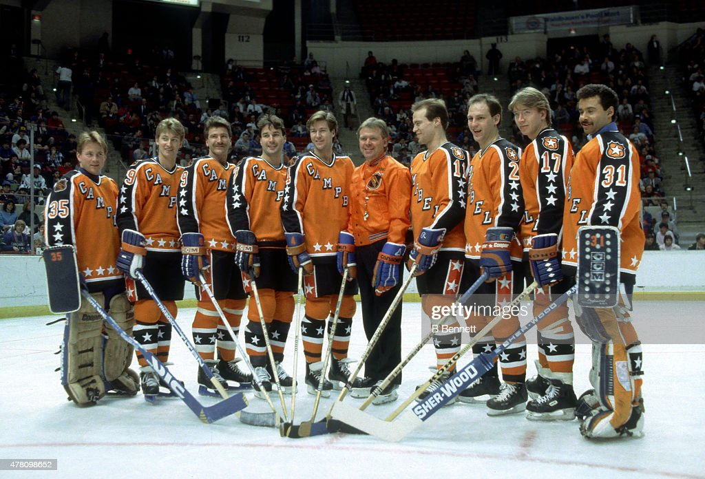Goalie Andy Moog #35, Wayne Gretzky #99, Glenn Anderson #9, Paul Coffey #7, Kevin Lowe #4, head coach Glen Sather, Mark Messier #11, Lee Fogolin #2, Jari Kurri #17 and goalie Grant Fuhr #31 of the Campbell Conference and the Edmonton Oilers pose for a portrait before the 1986 38th NHL All-Star Game against the Wales Conference on February 4, 1986 at the Hartford Civic Center in Hartford, Connecticut. The Wales Conference defeated the Campbell Conference 4-3.