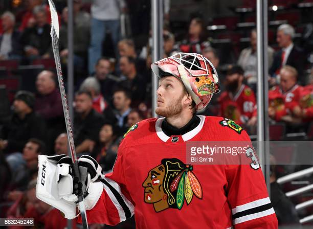 Goalie Anton Forsberg of the Chicago Blackhawks looks at the scoreboard in the second period against the Edmonton Oilers at the United Center on...