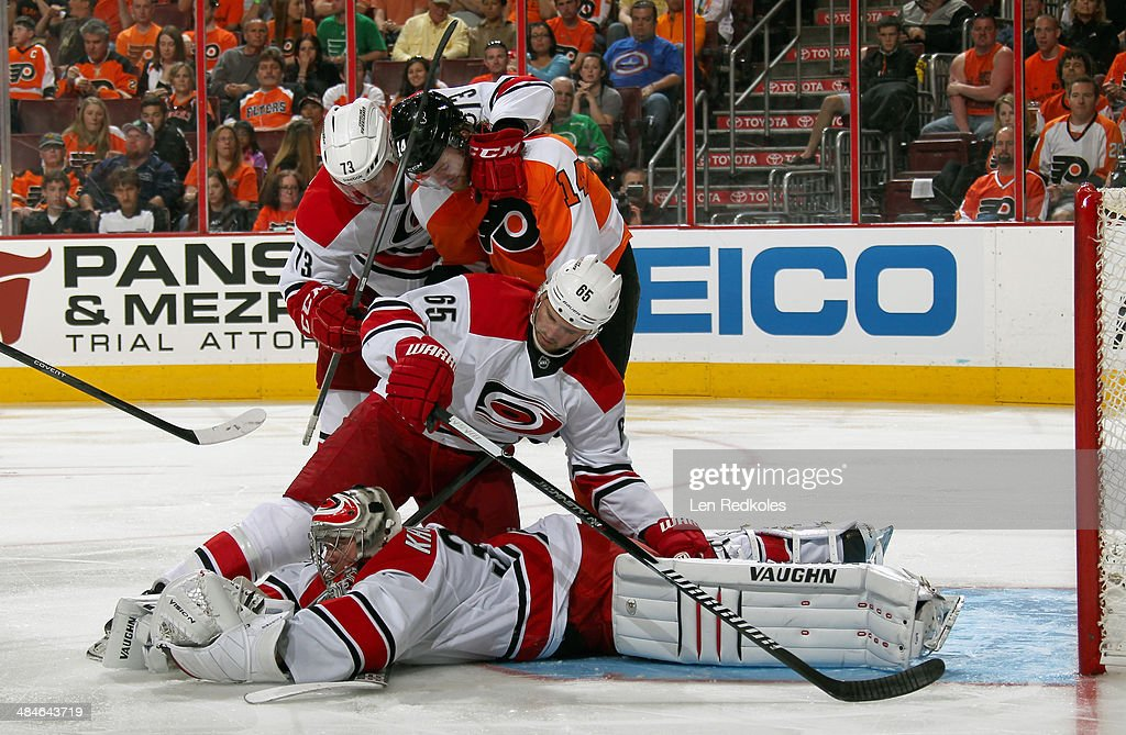 Goalie <a gi-track='captionPersonalityLinkClicked' href=/galleries/search?phrase=Anton+Khudobin&family=editorial&specificpeople=722106 ng-click='$event.stopPropagation()'>Anton Khudobin</a> #31 of the Carolina Hurricanes covers the puck after a save while teammates <a gi-track='captionPersonalityLinkClicked' href=/galleries/search?phrase=Brett+Bellemore&family=editorial&specificpeople=4270909 ng-click='$event.stopPropagation()'>Brett Bellemore</a> #73 and <a gi-track='captionPersonalityLinkClicked' href=/galleries/search?phrase=Ron+Hainsey&family=editorial&specificpeople=206345 ng-click='$event.stopPropagation()'>Ron Hainsey</a> #65 defend against <a gi-track='captionPersonalityLinkClicked' href=/galleries/search?phrase=Sean+Couturier&family=editorial&specificpeople=5663953 ng-click='$event.stopPropagation()'>Sean Couturier</a> #14 of the Philadelphia Flyers on April 13, 2014 at the Wells Fargo Center in Philadelphia, Pennsylvania. The Hurricanes went on to defeat the Flyers 6-5 in a shootout.
