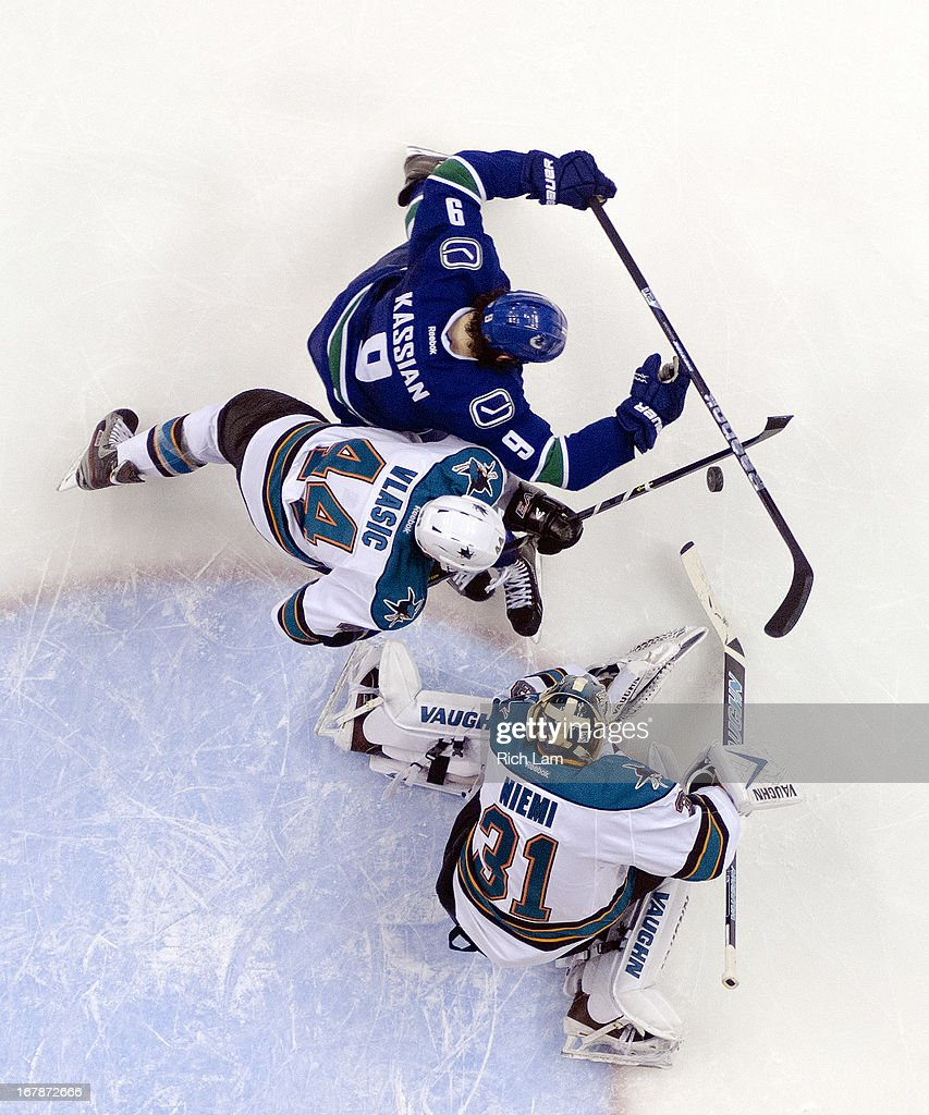 Goalie <a gi-track='captionPersonalityLinkClicked' href=/galleries/search?phrase=Antti+Niemi&family=editorial&specificpeople=213913 ng-click='$event.stopPropagation()'>Antti Niemi</a> #31 of the San Jose Sharks makes a save while <a gi-track='captionPersonalityLinkClicked' href=/galleries/search?phrase=Zack+Kassian&family=editorial&specificpeople=4604939 ng-click='$event.stopPropagation()'>Zack Kassian</a> #9 of the Vancouver Canucks battles with <a gi-track='captionPersonalityLinkClicked' href=/galleries/search?phrase=Marc-Edouard+Vlasic&family=editorial&specificpeople=880807 ng-click='$event.stopPropagation()'>Marc-Edouard Vlasic</a> #44 of the San Jose Sharks for the rebound during the first period in Game One of the Western Conference Quarterfinals of the 2013 NHL Stanley Cup Playoffs, May 01, 2013 at Rogers Arena in Vancouver, British Columbia, Canada.