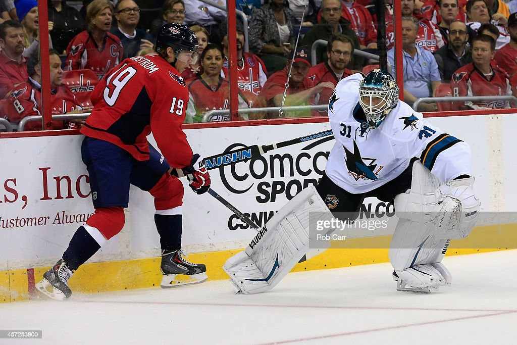 Goalie Antti Niemi #31 of the San Jose Sharks moves back to goal after passing the puck in front of Nicklas Backstrom #19 of the Washington Capitals during the first period at Verizon Center on October 14, 2014 in Washington, DC.