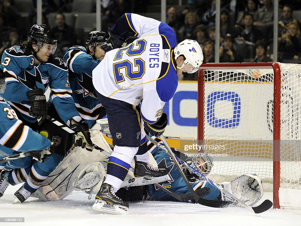 Goalie <a gi-track='captionPersonalityLinkClicked' href=/galleries/search?phrase=Antti+Niemi&family=editorial&specificpeople=213913 ng-click='$event.stopPropagation()'>Antti Niemi</a> #31of the San Jose Sharks gets help from teammates <a gi-track='captionPersonalityLinkClicked' href=/galleries/search?phrase=Dan+Boyle&family=editorial&specificpeople=201502 ng-click='$event.stopPropagation()'>Dan Boyle</a> #22 and Douglas Murray #3 stopping the shot of <a gi-track='captionPersonalityLinkClicked' href=/galleries/search?phrase=Brad+Boyes&family=editorial&specificpeople=275014 ng-click='$event.stopPropagation()'>Brad Boyes</a> #22 of the St. Louis Blues in the third period of an NHL hockey game at the HP Pavilion on January 15, 2011 in San Jose, California. The Sharks won the game 4-2.