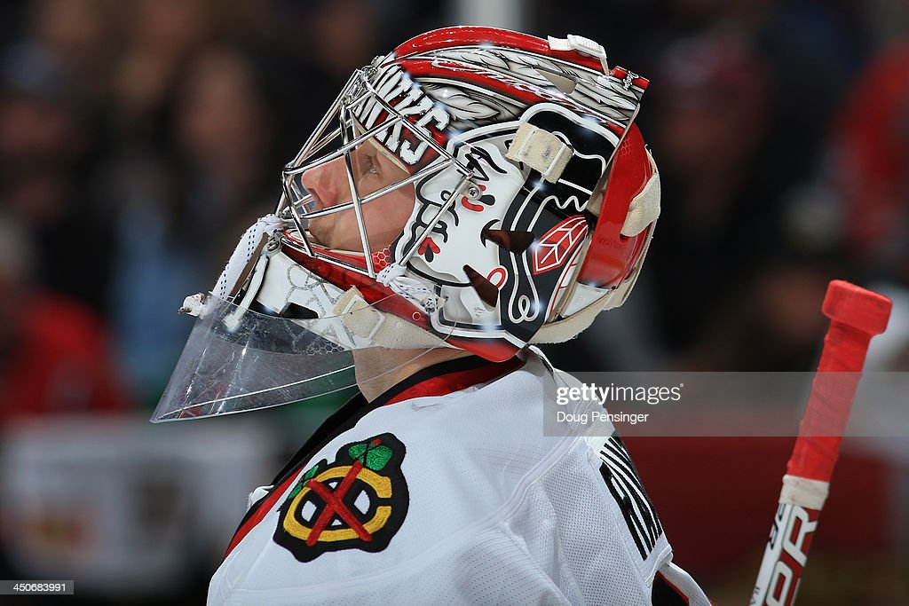 Goalie Antti Raanta #31 of the Chicago Blackhawks looks on during a break in the action as he defends the goal in his NHL debut against the Colorado Avalanche at Pepsi Center on November 19, 2013 in Denver, Colorado. The Avalacnhe defeated the Blackhawks 5-1.
