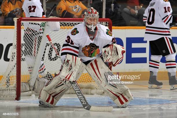 Goalie Antti Raanta of the Chicago Blackhawks plays against the Nashville Predators at Bridgestone Arena on April 12 2014 in Nashville Tennessee