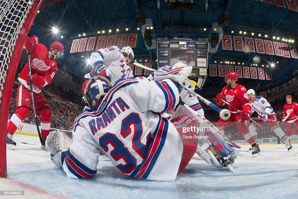 Goalie Antti Raanta #32 of the New York Rangers tries to find the puck around players in the front of the net during an NHL game against the Detroit Red Wings at Joe Louis Arena on March 12, 2017 in Detroit, Michigan. The Rangers defeated the Wings 4-1.