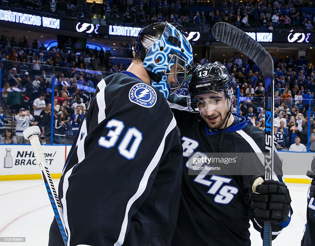 30 White NHL Jersey Goalie Ben Bishop 30 and Cedric Paquette 13 of the Tampa  Bay Lightning celebrate ... b0c94efcc