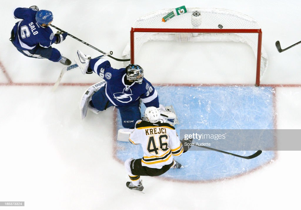 Goalie <a gi-track='captionPersonalityLinkClicked' href=/galleries/search?phrase=Ben+Bishop&family=editorial&specificpeople=700137 ng-click='$event.stopPropagation()'>Ben Bishop</a> #30 and <a gi-track='captionPersonalityLinkClicked' href=/galleries/search?phrase=Sami+Salo&family=editorial&specificpeople=206132 ng-click='$event.stopPropagation()'>Sami Salo</a> #6 of the Tampa Bay Lightning watch the puck go in the net for a goal by <a gi-track='captionPersonalityLinkClicked' href=/galleries/search?phrase=David+Krejci&family=editorial&specificpeople=722556 ng-click='$event.stopPropagation()'>David Krejci</a> #46 of the Boston Bruins during the first period at the Tampa Bay Times Forum on October 19, 2013 in Tampa, Florida.