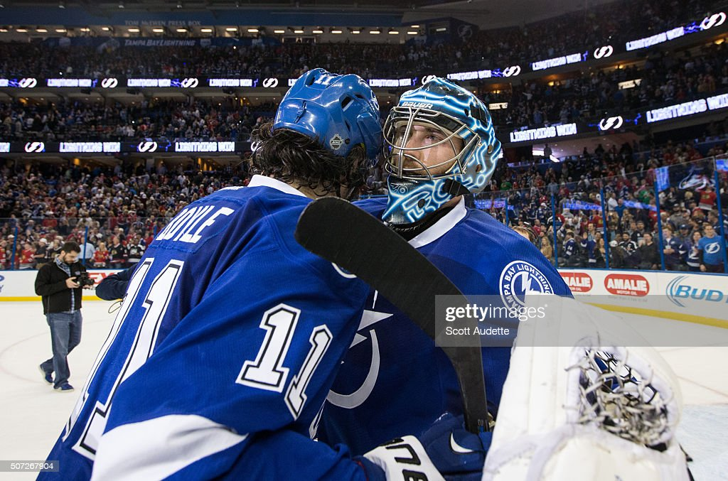 Goalie <a gi-track='captionPersonalityLinkClicked' href=/galleries/search?phrase=Ben+Bishop&family=editorial&specificpeople=700137 ng-click='$event.stopPropagation()'>Ben Bishop</a> #30 of the Tampa Bay Lightning and <a gi-track='captionPersonalityLinkClicked' href=/galleries/search?phrase=Brian+Boyle+-+Hockey+sur+glace&family=editorial&specificpeople=8986264 ng-click='$event.stopPropagation()'>Brian Boyle</a> #11 celebrate the win against the Chicago Blackhawks at the Amalie Arena on January 21, 2016 in Tampa, Florida.