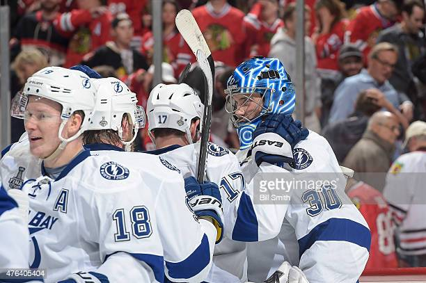 Goalie Ben Bishop of the Tampa Bay Lightning celebrates with teammates after defeating the Chicago Blackhawks 32 during Game Three of the 2015 NHL...