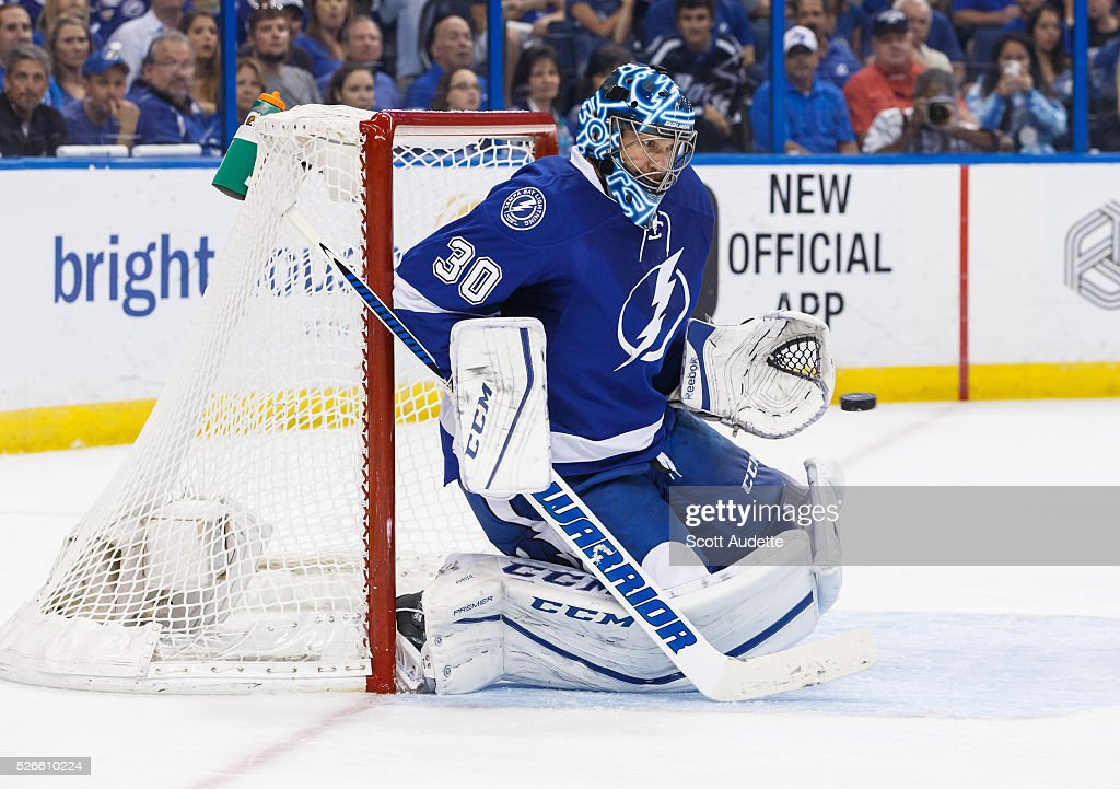 Goalie <a gi-track='captionPersonalityLinkClicked' href=/galleries/search?phrase=Ben+Bishop&family=editorial&specificpeople=700137 ng-click='$event.stopPropagation()'>Ben Bishop</a> #30 of the Tampa Bay Lightning makes a save against the New York Islanders during the second period of Game Two of the Eastern Conference Second Round in the 2016 NHL Stanley Cup Playoffs at the Amalie Arena on April 30, 2016 in Tampa, Florida.