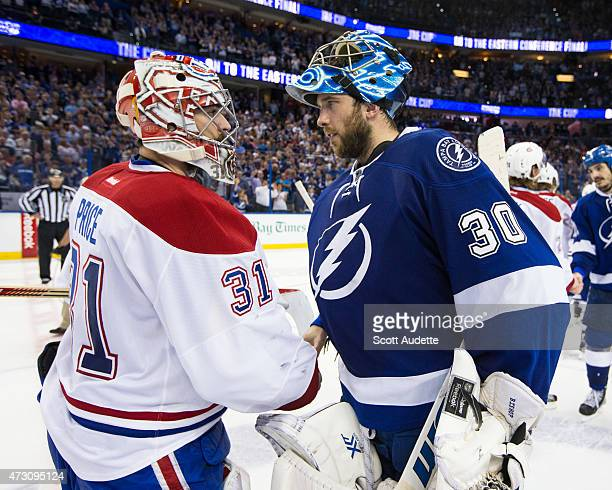 Goalie Ben Bishop of the Tampa Bay Lightning shakes hands with goalie Carey Price of the Montreal Canadiens after the series win after Game Six of...