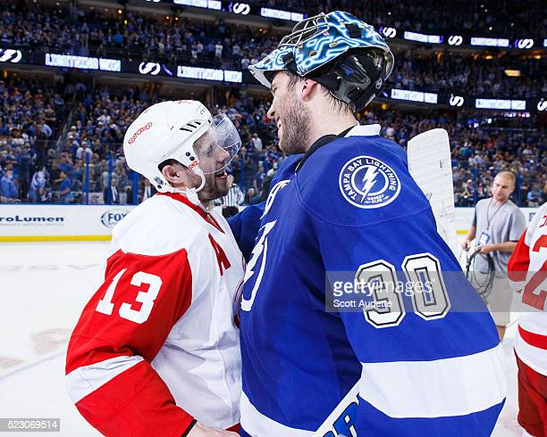 Goalie Ben Bishop of the Tampa Bay Lightning shakes the hand of Pavel Datsyuk of the Detroit Red Wings after the series win in Game Five of the...