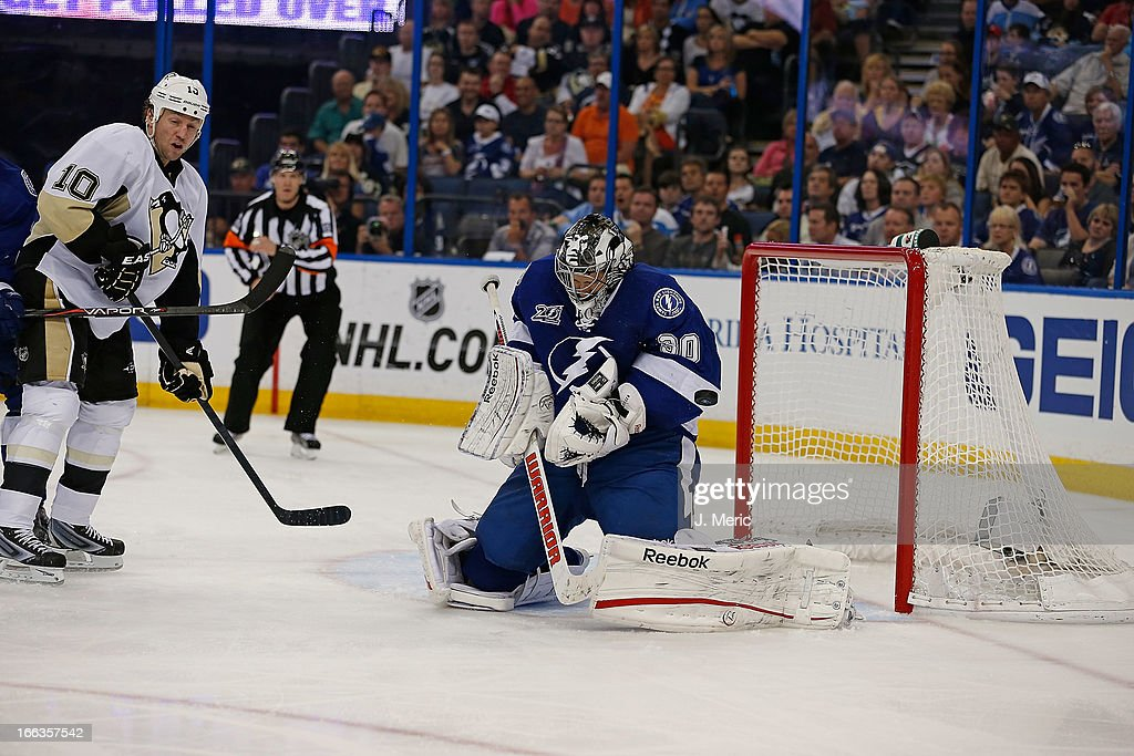 Goalie <a gi-track='captionPersonalityLinkClicked' href=/galleries/search?phrase=Ben+Bishop&family=editorial&specificpeople=700137 ng-click='$event.stopPropagation()'>Ben Bishop</a> #30 of the Tampa Bay Lightning stops a shot from the Pittsburgh Penguins during the game at the Tampa Bay Times Forum on April 11, 2013 in Tampa, Florida.