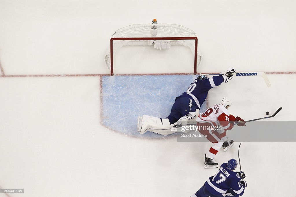Goalie Ben Bishop of the Tampa Bay Lightning stretches to make a save against Joakim Andersson of the Detroit Red Wings during the third period at...
