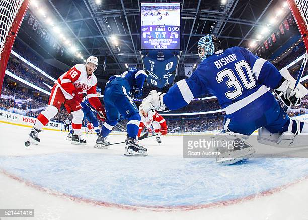 Goalie Ben Bishop of the Tampa Bay Lightning stretches to make a save against Joakim Andersson of the Detroit Red Wings during the first period of...