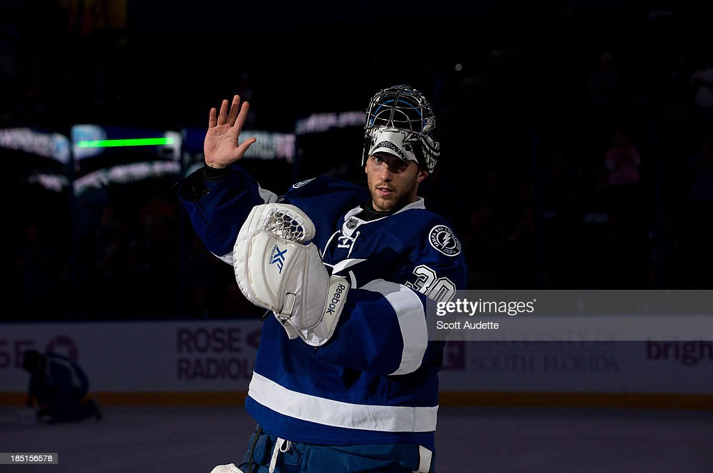 Goalie <a gi-track='captionPersonalityLinkClicked' href=/galleries/search?phrase=Ben+Bishop&family=editorial&specificpeople=700137 ng-click='$event.stopPropagation()'>Ben Bishop</a> #30 of the Tampa Bay Lightning thanks fans after tonight's win against the Minnesota Wild at the Tampa Bay Times Forum on October 17, 2013 in Tampa, Florida.