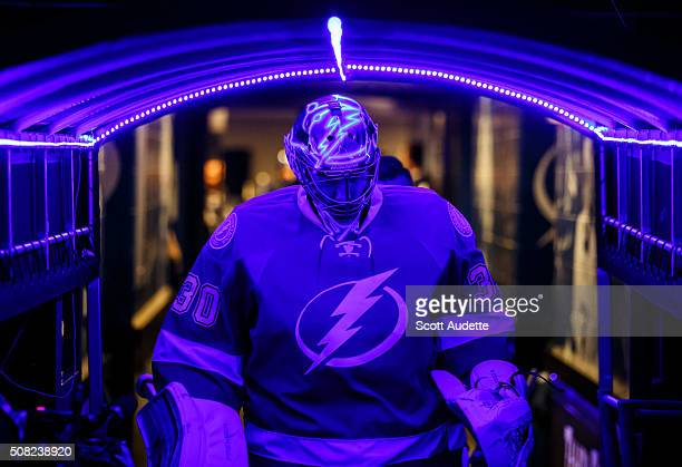 Goalie Ben Bishop of the Tampa Bay Lightning walks through a blue lit tunnel before pregame warm ups against the Detroit Red Wings at the Amalie...