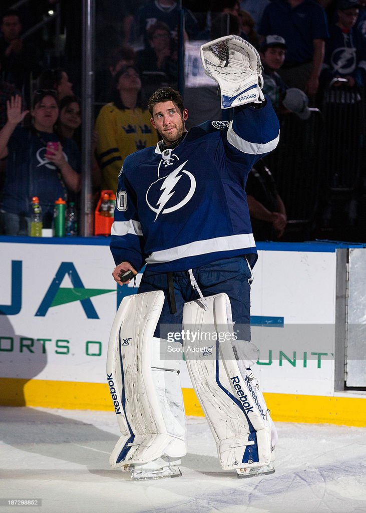 Goalie <a gi-track='captionPersonalityLinkClicked' href=/galleries/search?phrase=Ben+Bishop&family=editorial&specificpeople=700137 ng-click='$event.stopPropagation()'>Ben Bishop</a> #30 Tampa Bay Lightning thanks fans for their support after being named the first star of the game against the Edmonton Oilers the Tampa Bay Times Forum on November 7, 2013 in Tampa, Florida.