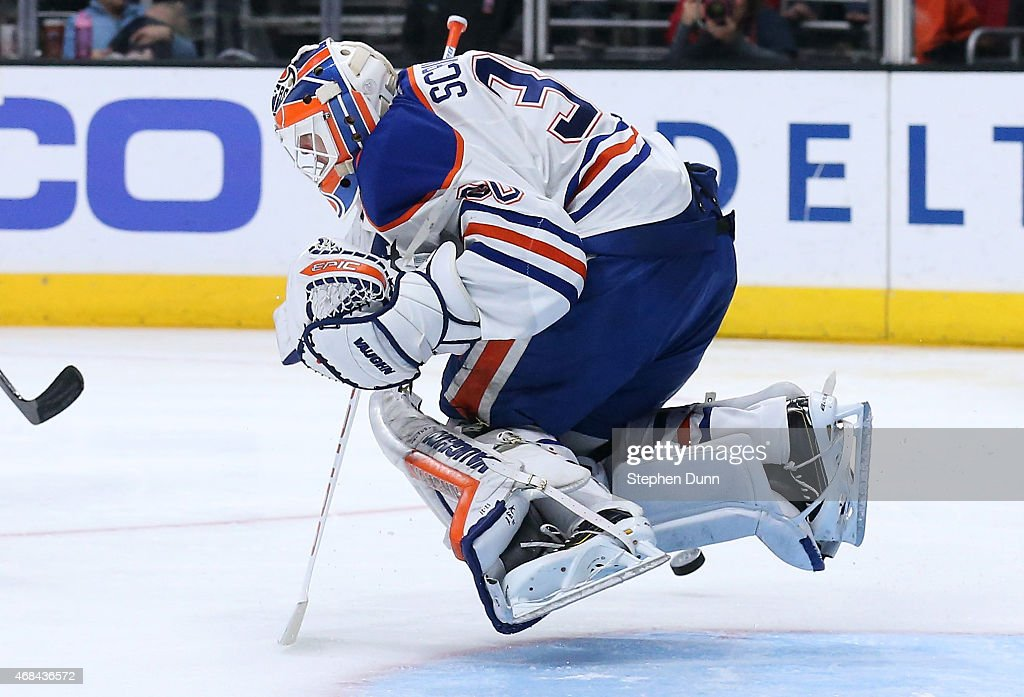 Goalie Ben Scrivens of the Edmonton Oilers hops as he makes a save against the Los Angeles Kings at Staples Center on April 2 2015 in Los Angeles...