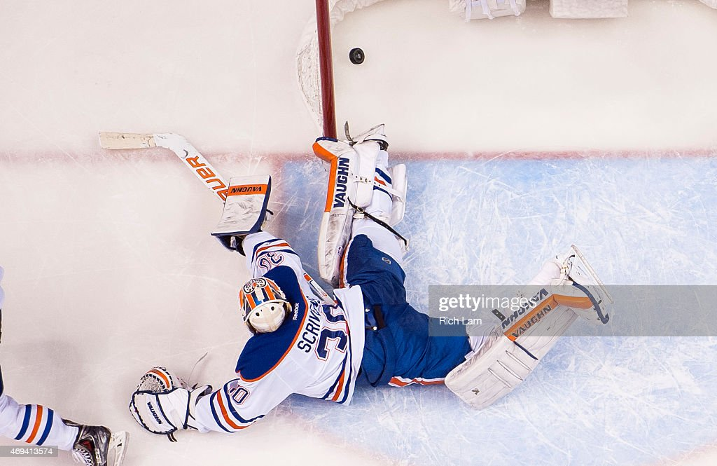 Goalie Ben Scrivens #30 of the Edmonton Oilers watches Alexander Edler #23 of the Vancouver Canucks shot go into the net for the game winning goal in NHL action on April, 11, 2015 at Rogers Arena in Vancouver, British Columbia, Canada.