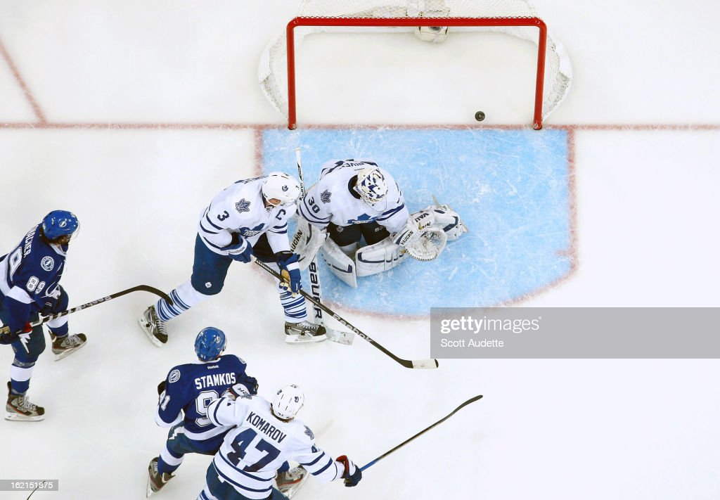Goalie <a gi-track='captionPersonalityLinkClicked' href=/galleries/search?phrase=Ben+Scrivens&family=editorial&specificpeople=7185205 ng-click='$event.stopPropagation()'>Ben Scrivens</a> #30 of the Toronto Maple Leafs allows for a Lightning goal during the second period of the game at the Tampa Bay Times Forum on February 19, 2013 in Tampa, Florida.