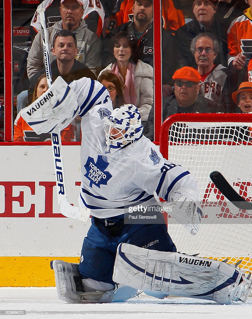 Goalie <a gi-track='captionPersonalityLinkClicked' href=/galleries/search?phrase=Ben+Scrivens&family=editorial&specificpeople=7185205 ng-click='$event.stopPropagation()'>Ben Scrivens</a> #30 of the Toronto Maple Leafs makes a save in the third period of an NHL Hockey game against the Philadelphia Flyers at Wells Fargo Center on February 25, 2013 in Philadelphia, Pennsylvania.