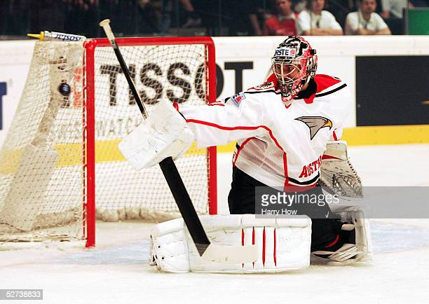 Goalie Bernd Brueckler of Austria makes a stick save against Russia during the IIHF World Men's Championships preliminary round game at Wiener...