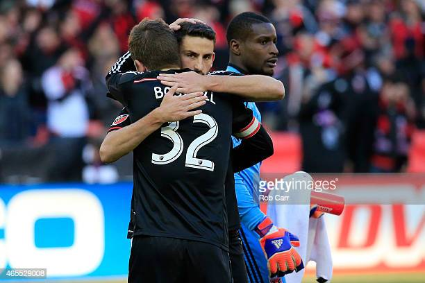 Goalie Bill Hamid looks on as Bobby Boswell and Steve Birnbaum of DC United celebrate their 10 win over Montreal Impact at RFK Stadium on March 7...