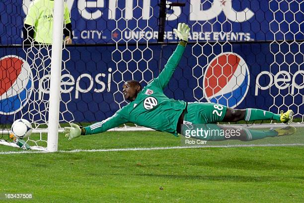 Goalie Bill Hamid of DC United dives after the ball during the second half against the Real Salt Lake at RFK Stadium on March 9 2013 in Washington DC