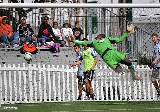Goalie Bill Hamid of DC United dives for a ball against the Montreal Impact February 16 2013 in the third round of the Disney Pro Soccer Classic in...