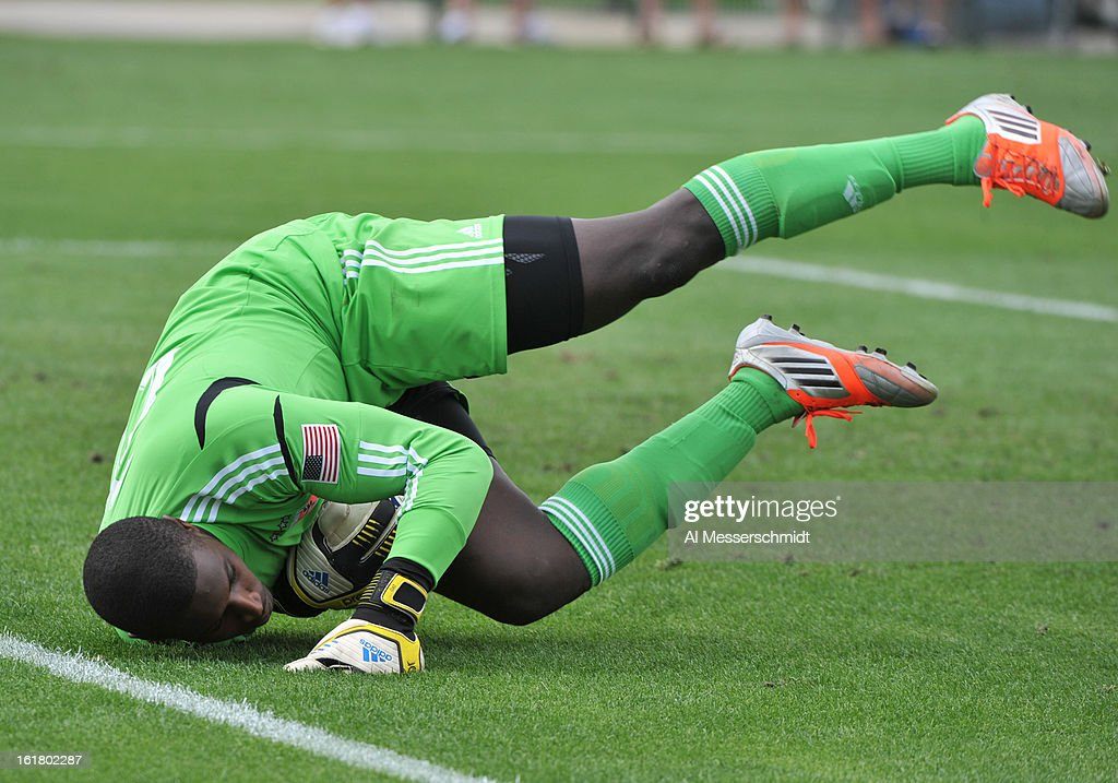 Goalie Bill Hamid #28 of DC United tumbles to make a save against the Montreal Impact February 16, 2013 in the third round of the Disney Pro Soccer Classic in Orlando, Florida.