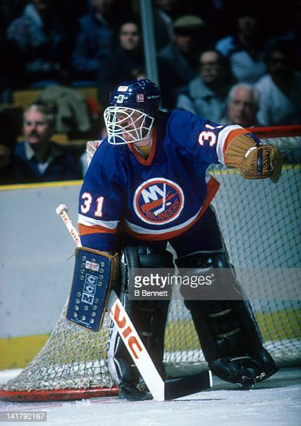 Goalie Billy Smith of the New York Islanders defends the net during an NHL game circa 1987