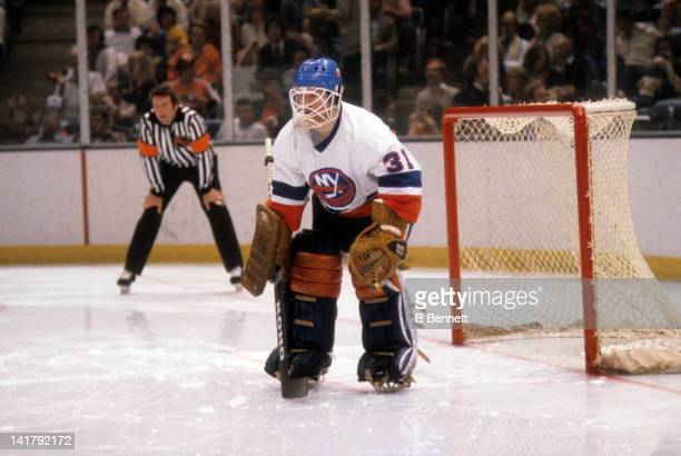 Goalie Billy Smith of the New York Islanders defends the net during the 1980 Stanley Cup Finals against the Philadelphia Flyers in May 1980 at the...