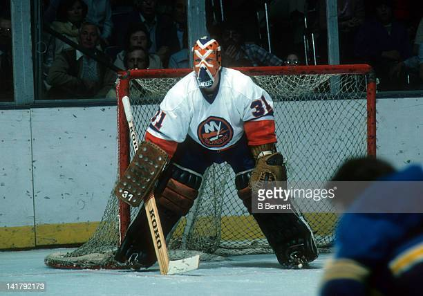 Goalie Billy Smith of the New York Islanders defends the net during an NHL game circa 1976 at the Nassau Coliseum in Uniondale New York