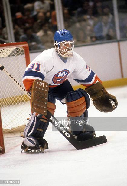 Goalie Billy Smith of the New York Islanders defends the net during an NHL game in March 1986 at the Nassau Coliseum in Uniondale New York