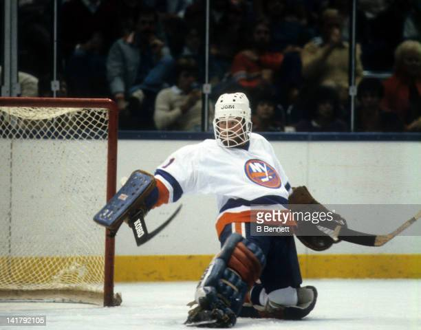 Goalie Billy Smith of the New York Islanders makes the save during an NHL game in October 1983 at the Nassau Coliseum in Uniondale New York