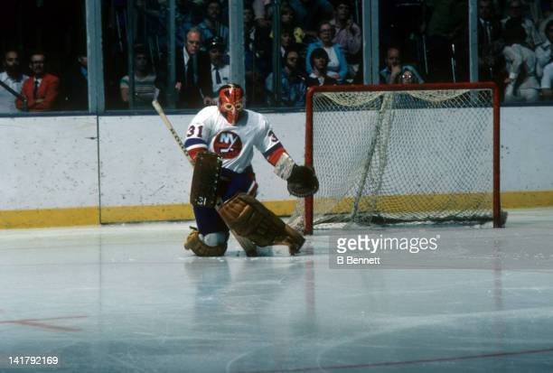 Goalie Billy Smith of the New York Islanders makes the save during an NHL game circa 1977 at the Nassau Coliseum in Uniondale New York