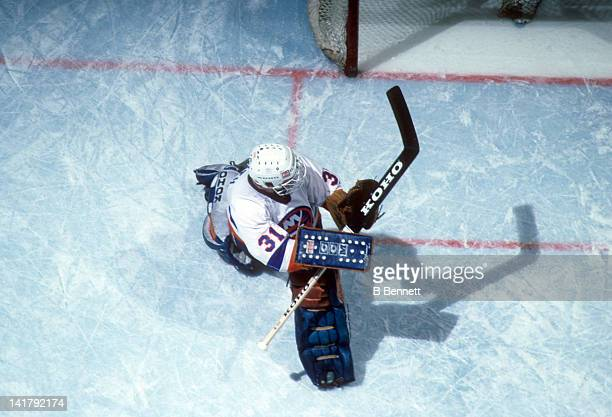 Goalie Billy Smith of the New York Islanders makes the save during an NHL game in May 1984 at the Nassau Coliseum in Uniondale New York
